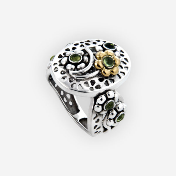 Two tone cutout flower ring with peridot gemstones and crafted in 925 sterling silver and 14k gold.