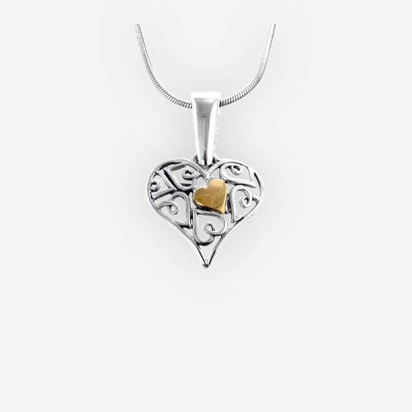 Two-tone silver filigree heart pendant is crafted from 925 sterling silver with an embossed 14k gold detail.