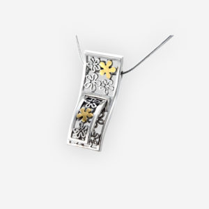 Two-tone openwork flower necklace crafted in 925 sterling silver and 14k gold on a silver chain.
