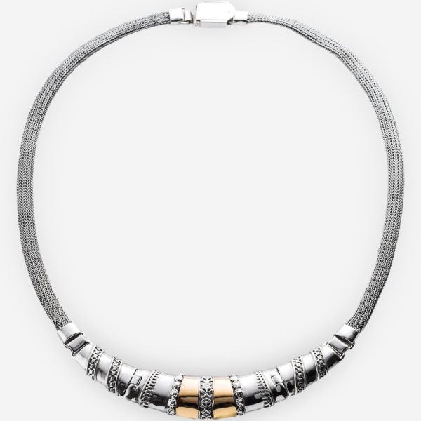 Two tone silver collar necklace with sterling silver floral motif and 14k gold details.