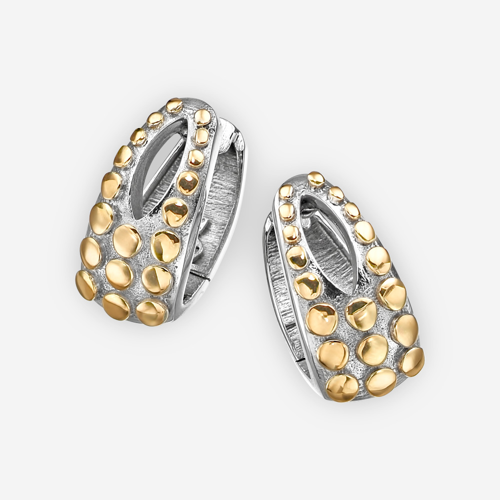 Sterling silver two tone earrings with embossed 14k gold dots, cut out design, and huggie closure.