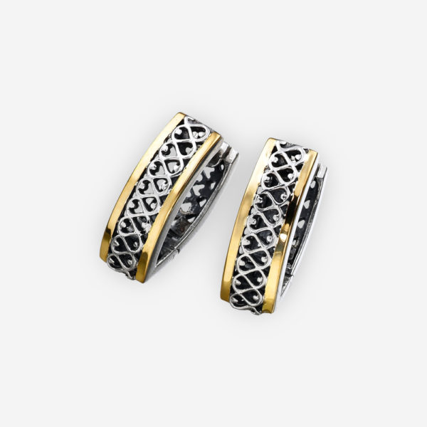 Sterling silver and 14k gold two tone huggie earrings with open filigree detailed design accented with gold elements.
