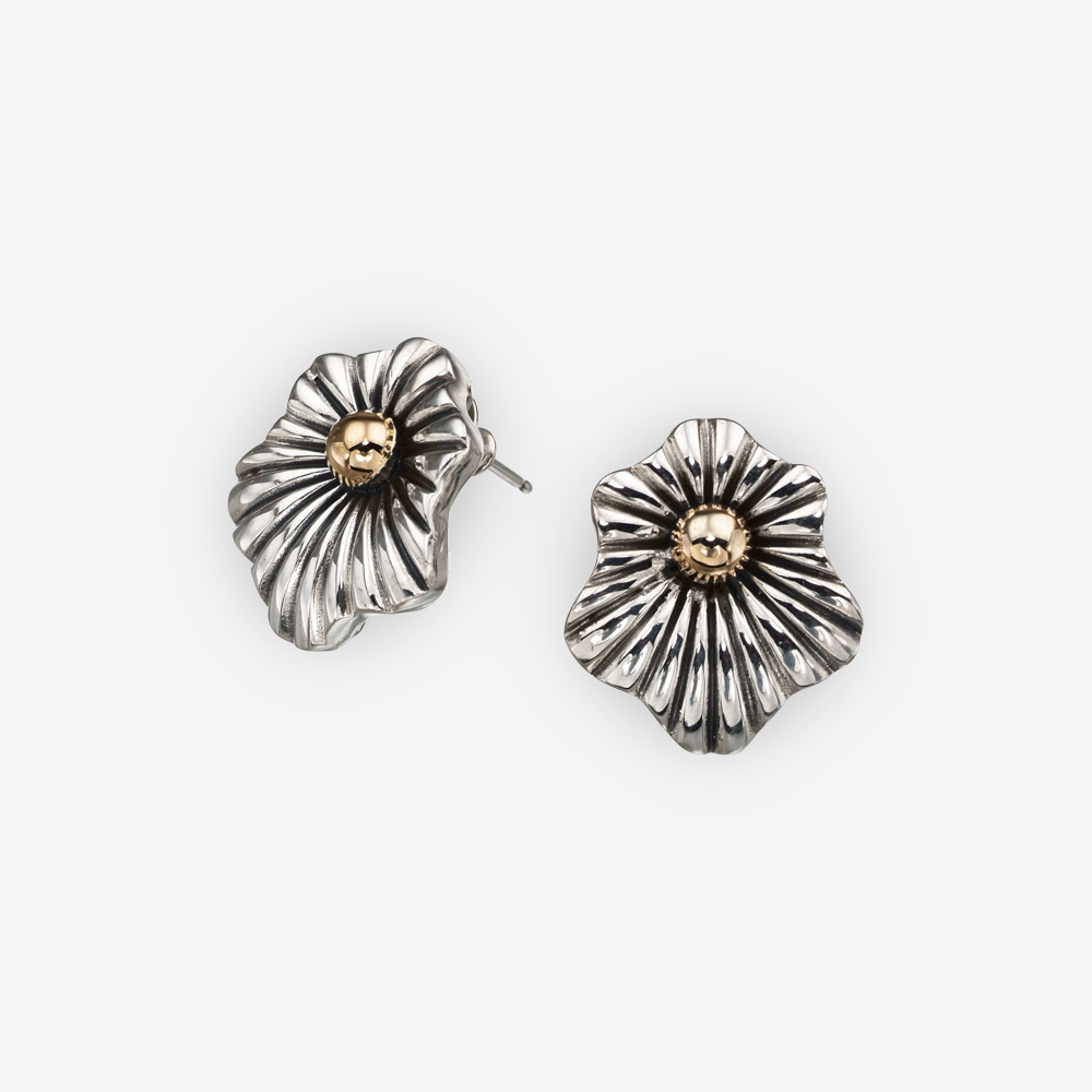 Elegant two tone sterling silver clip earrings with abstract flower design and 14k gold center.