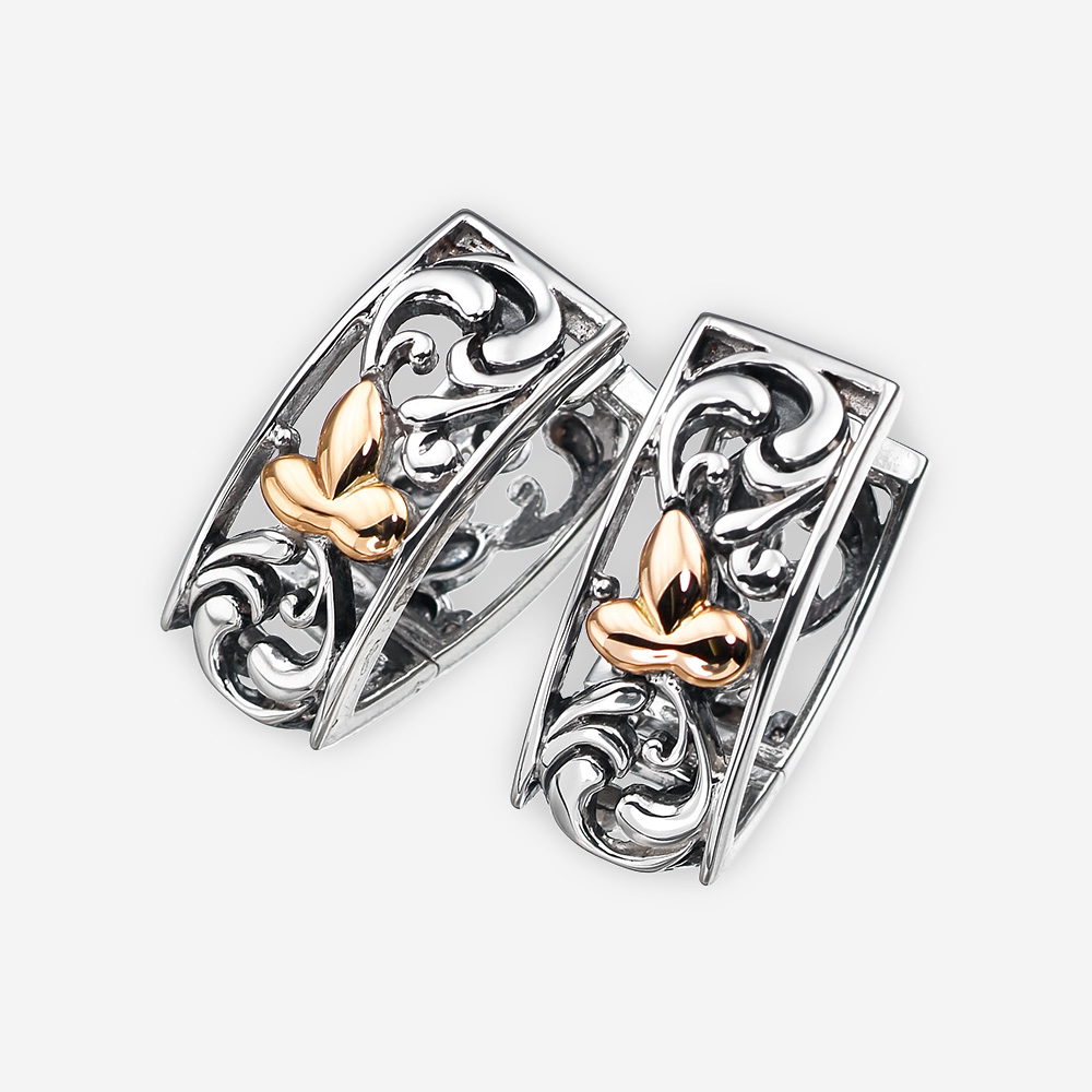 Two tone silver floral filigree earrings crafted from 925 sterling silver and 14k gold.