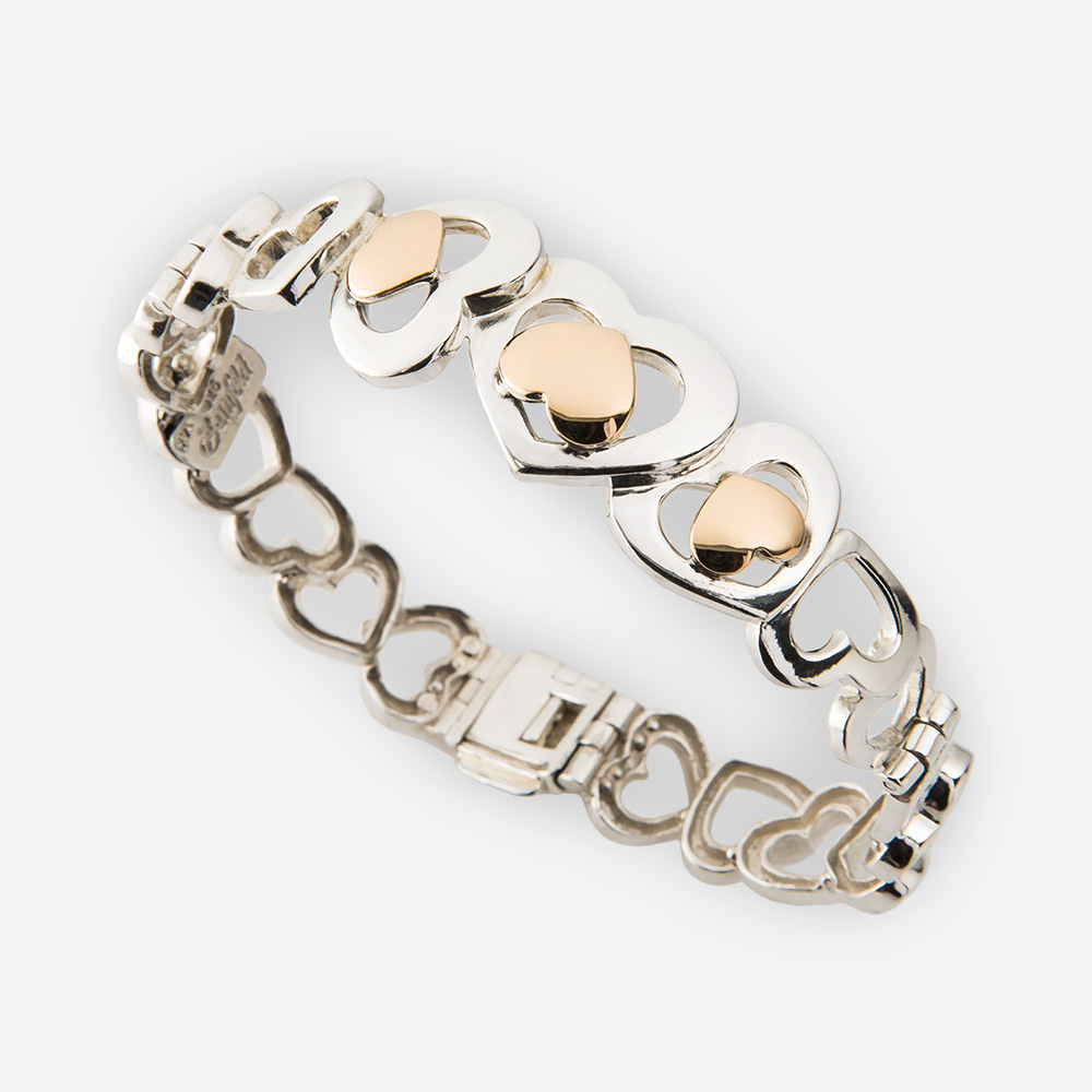Silver heart bracelet with lovely two-tone multiple heart links.