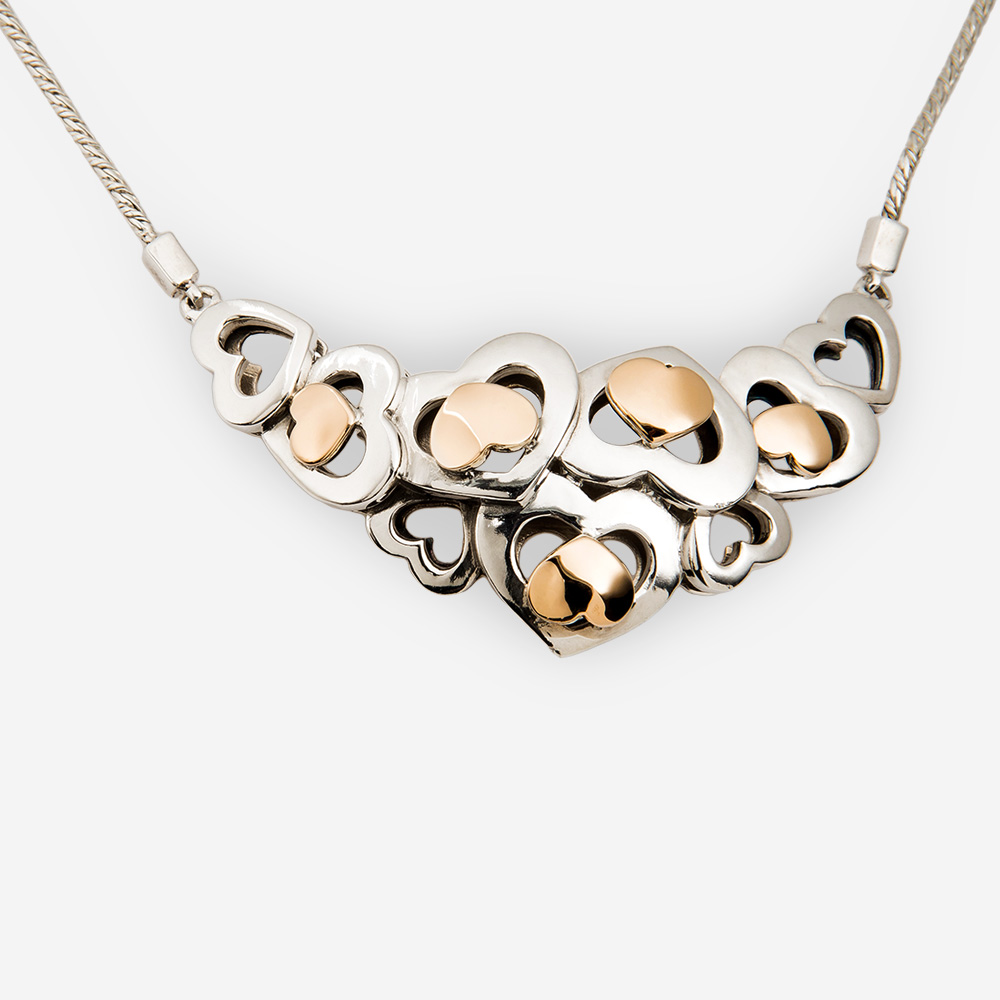 Two Tone Sterling Silver Heart Necklace with 14k Gold Hearts.