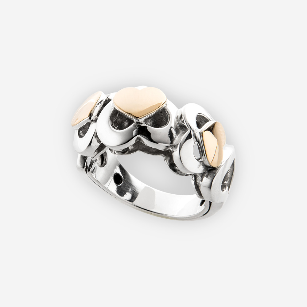Lovely sterling silver heart ring featuring a two-tone multiple heart cut out design and 14k gold accents.