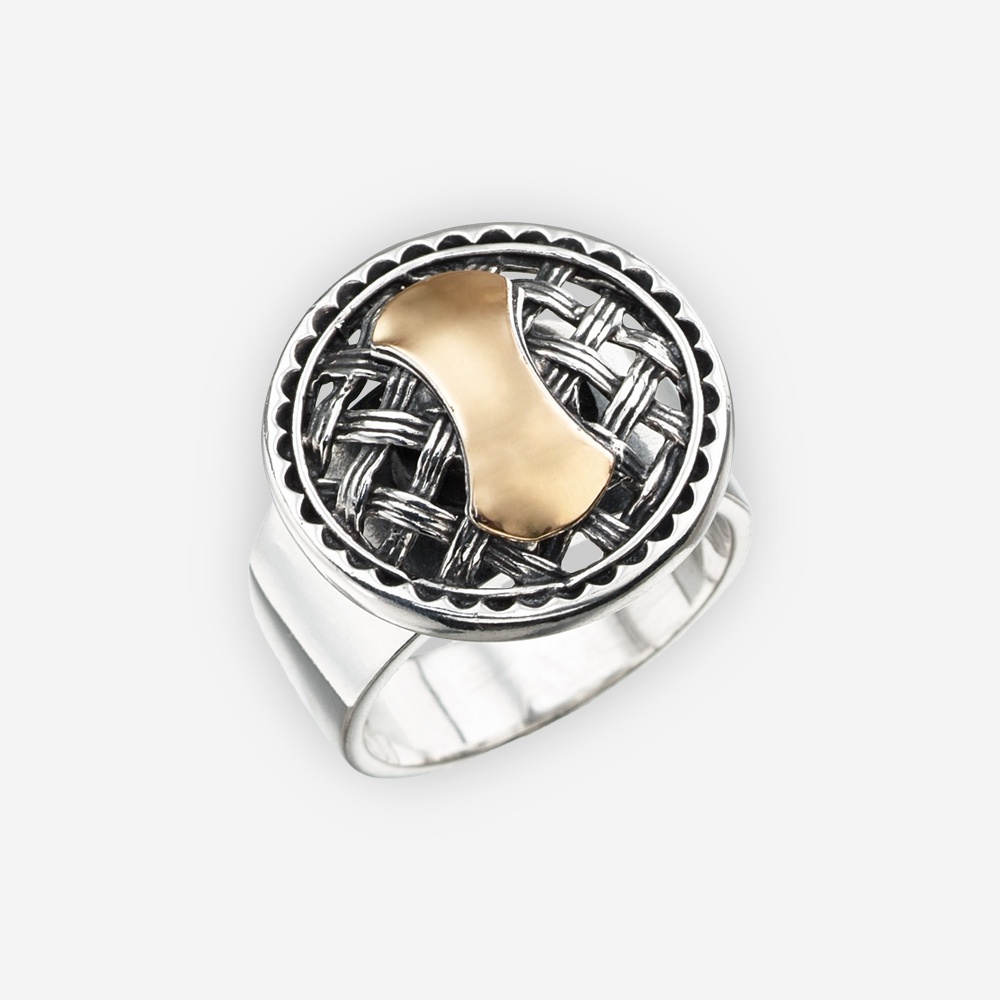 Two tone silver ring with an intricate lattice work medallion centerpiece and a gold design in the middle.