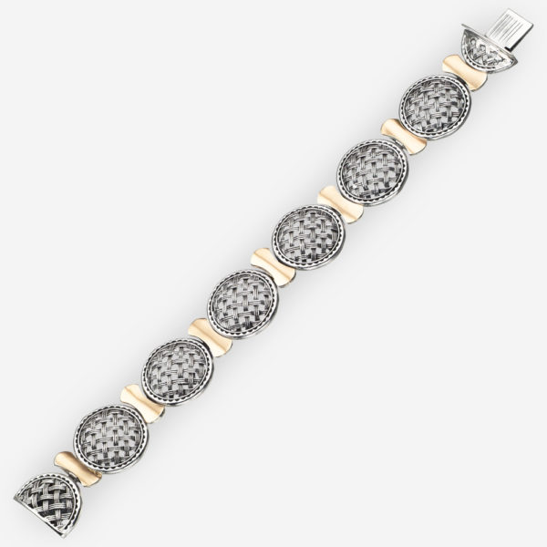 Two tone silver lattice link bracelet featuring intricate lattice work medallions and gold links.