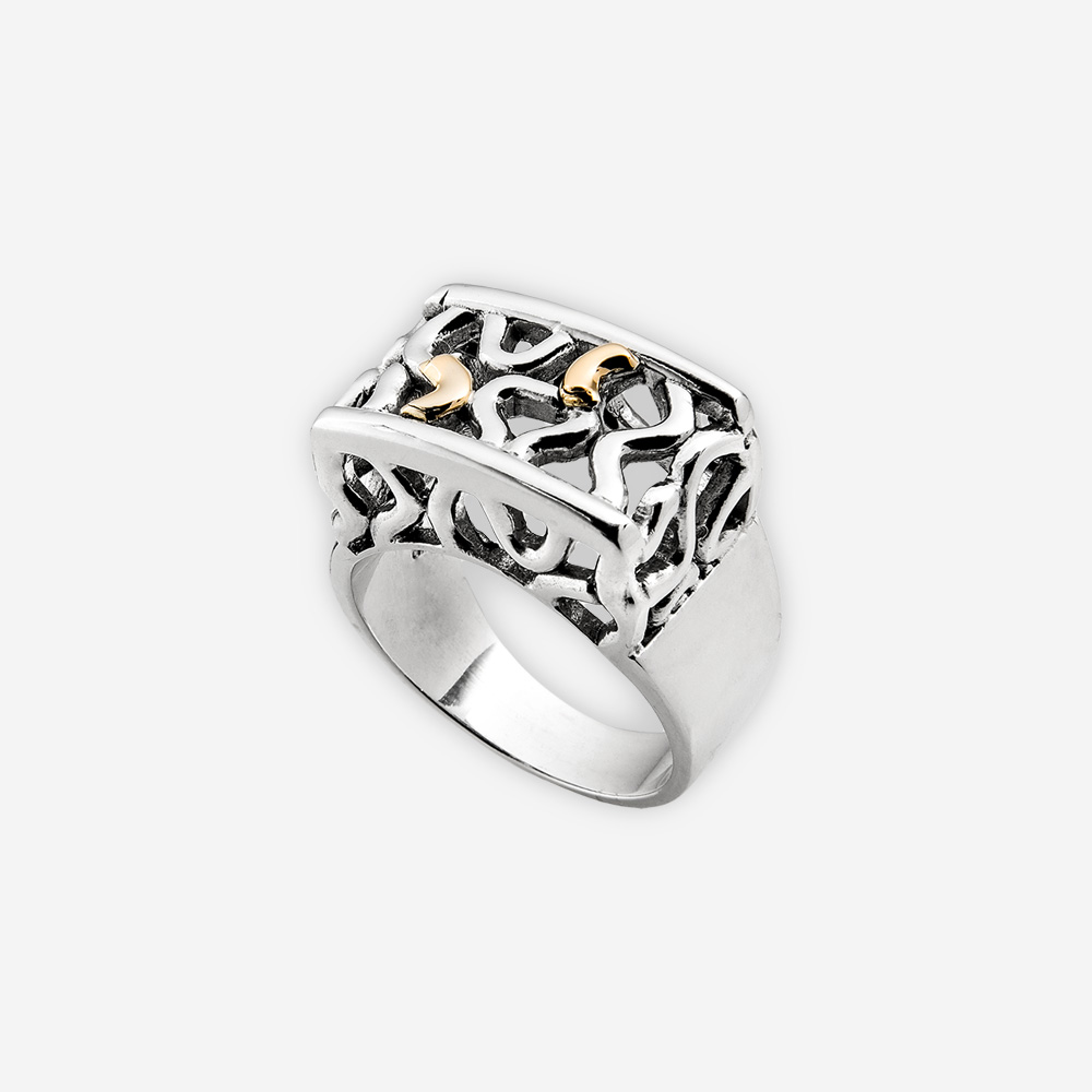 Two Tone silver openwork ring with abstract motif and 14k gold accent details.