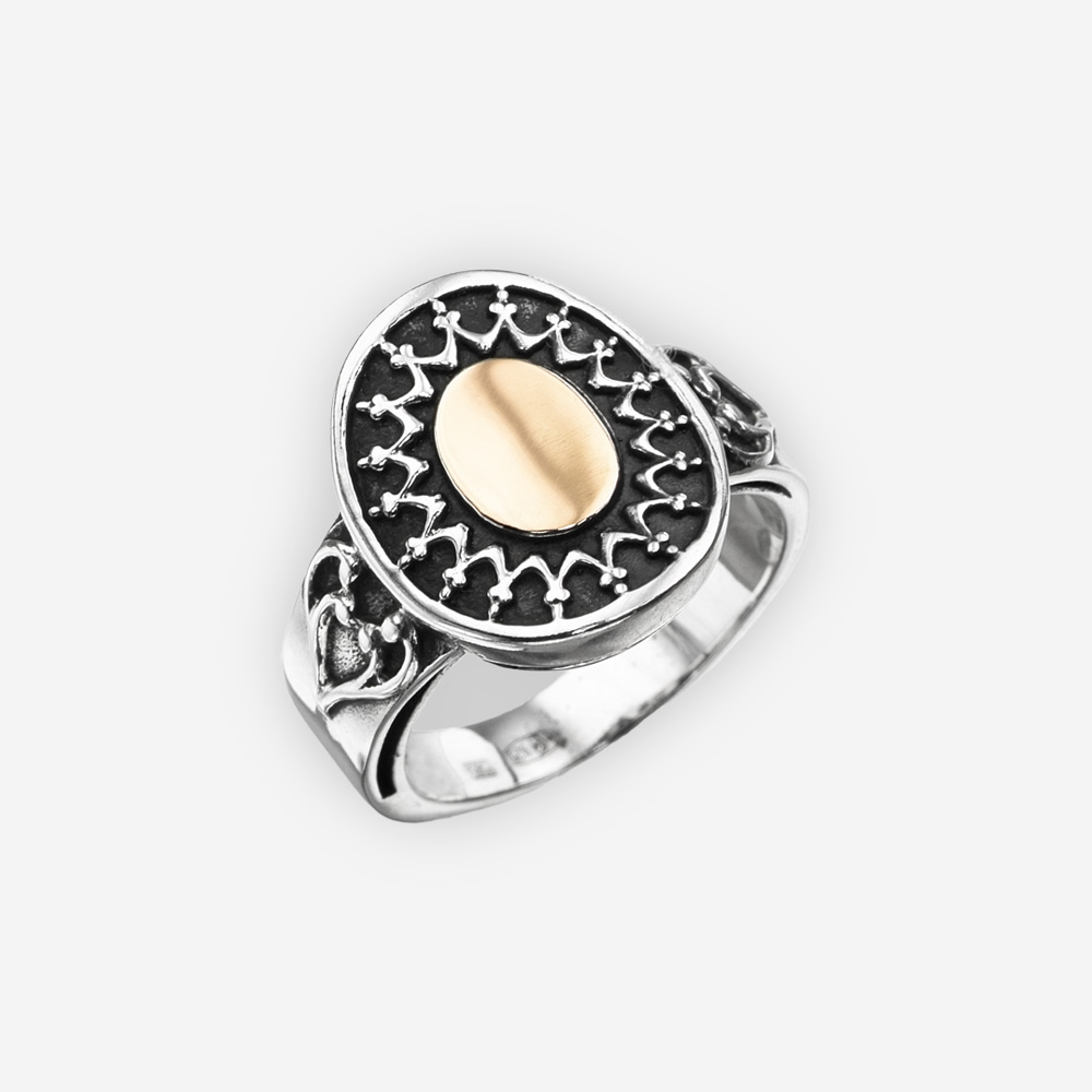 Two tone sterling silver statement ring with sterling silver and gold element details.