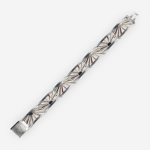 Beautiful two tone silver sunrise link bracelet with detailed cut out sunrise design.