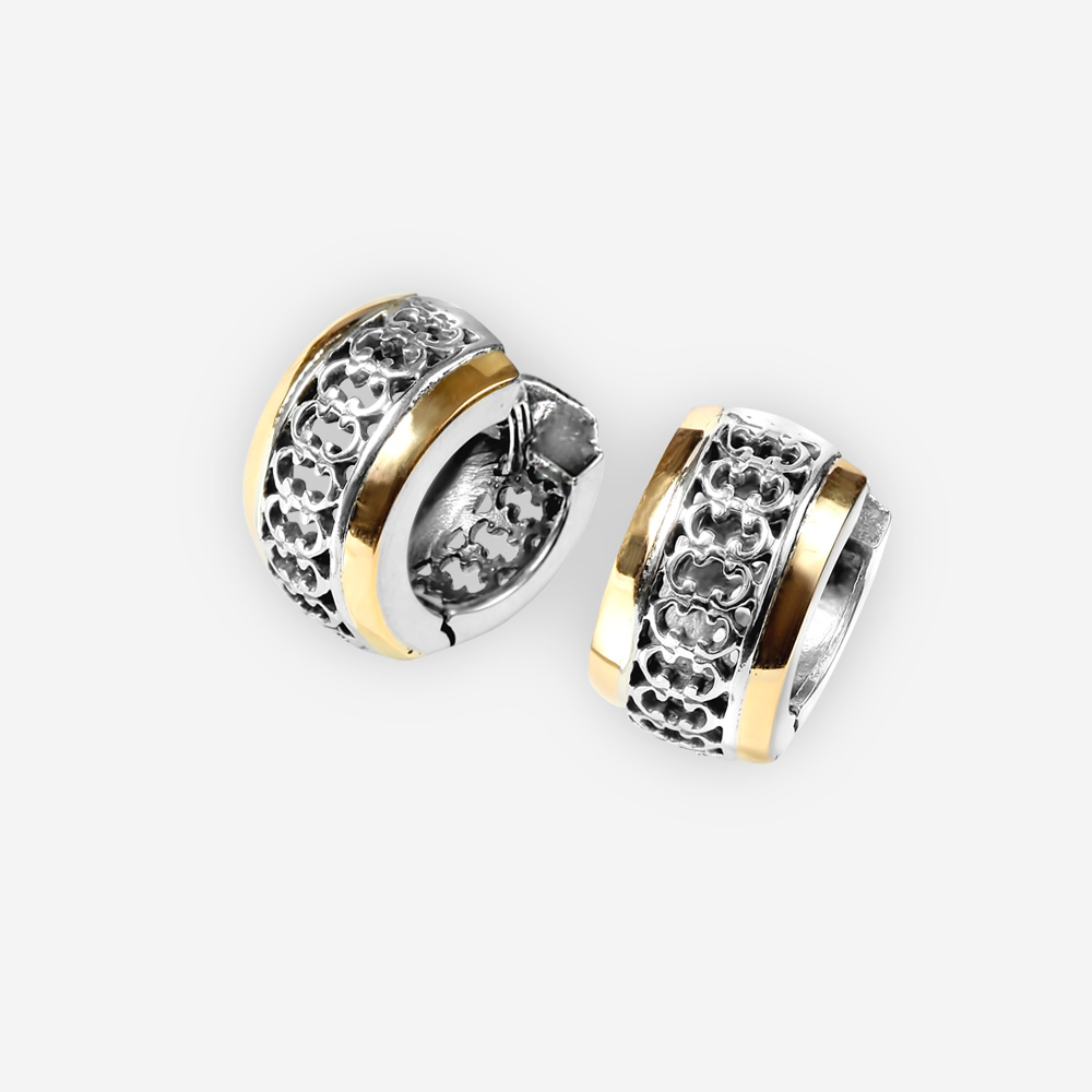 Two tone silver hoops featuring sterling silver and 14k gold with cut out filigree design details.