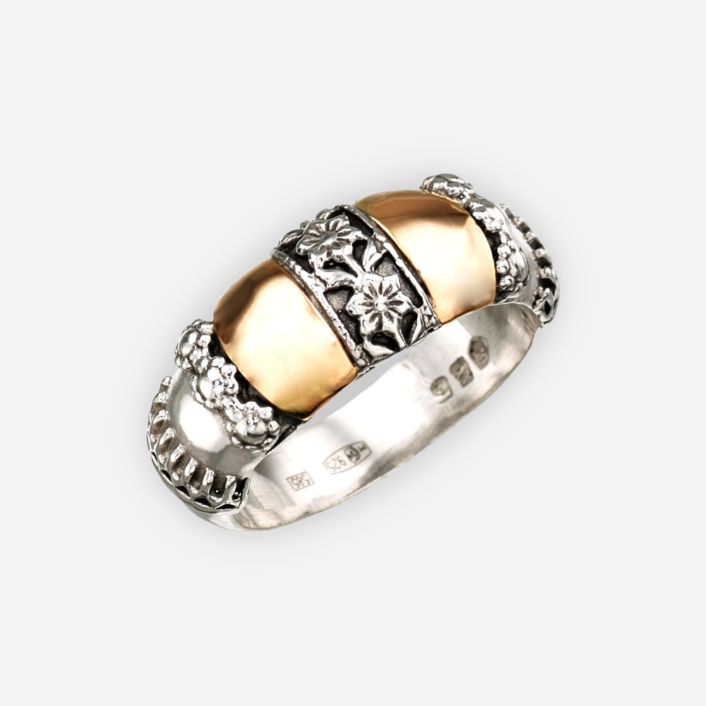 Two tone sterling silver floral ring with 14k gold details.
