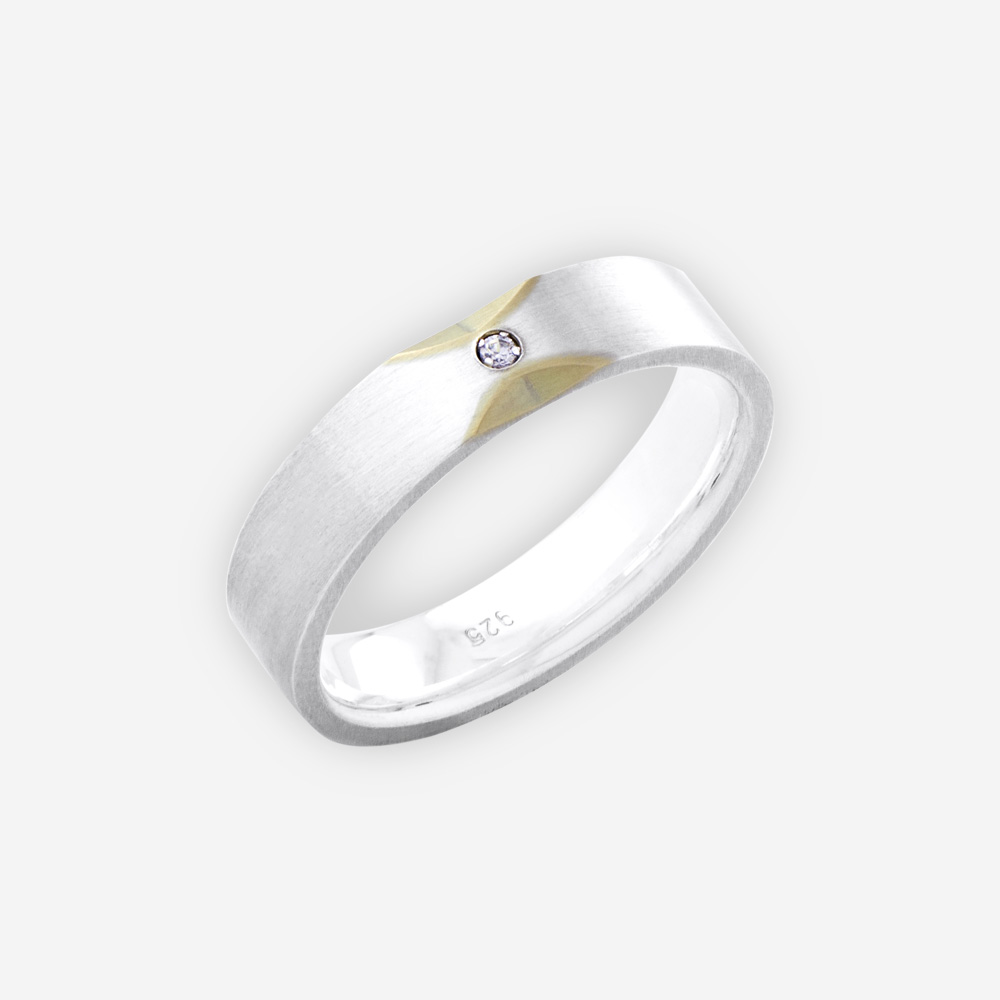 Two tone thick unisex silver band with 14k gold accents and small CZ stone.