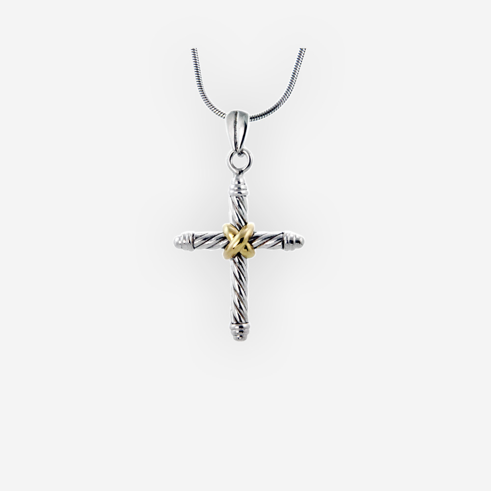 Two-tone twisted cable religious cross pendant features a sterling silver twisted cable design and 14k gold detail.