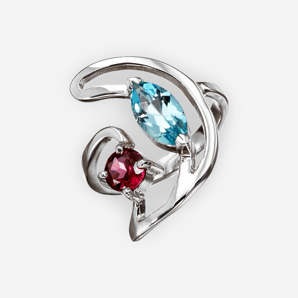 Unique silver ring with garnet and blue topaz gemstones and is crafted from 925 sterling silver.