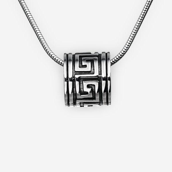 Unisex silver Byzantine pendant with an oxidized finish.