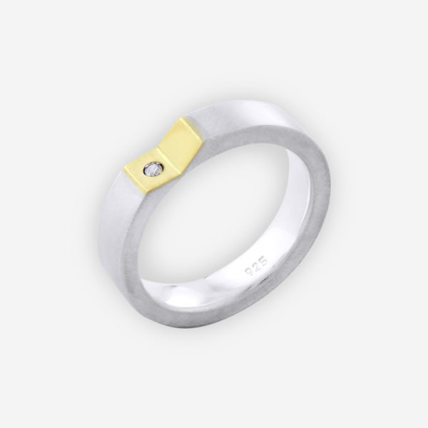 Unisex two tone silver modern band with polished finish, angled concave 14k gold upper, and small cubic zirconia stone.