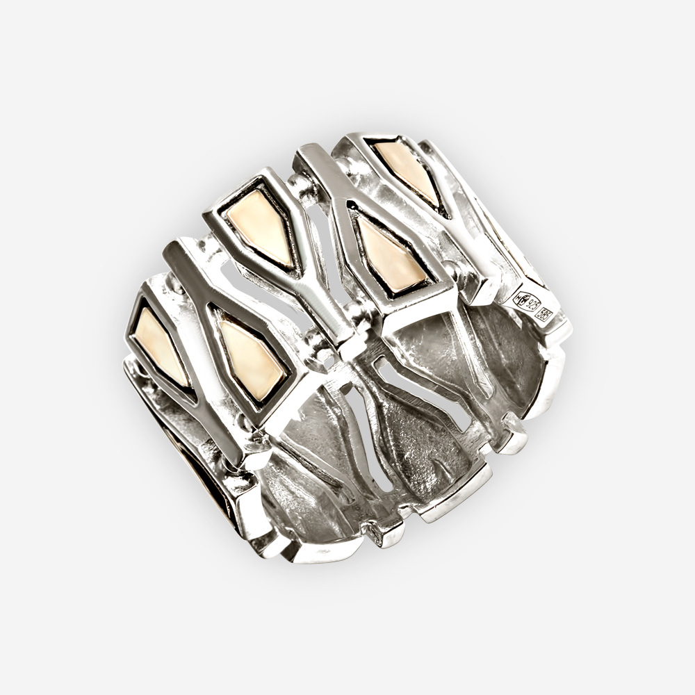 A wide geometric fragments silver ring crafted in 925 sterling silver with 14k gold accents.