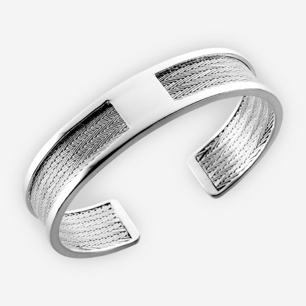 Classic and chic silver cuff bracelet. It features a woven herringbone design and is made from 925 sterling silver.